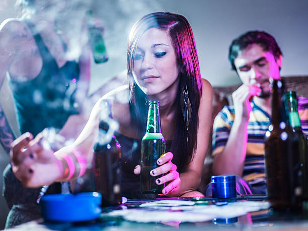 girl putting joint in ashtray at crazy party - narcotic stock pictures, royalty-free photos & images