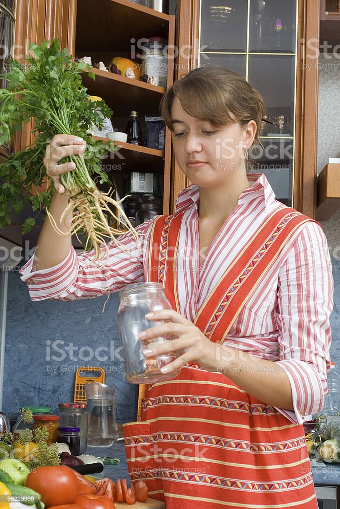 Girl putting parsley royalty-free stock photo