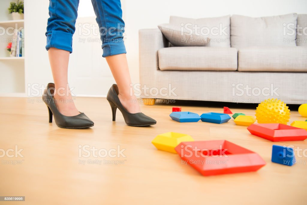 girl quietly playing her mother shoes - foto stock