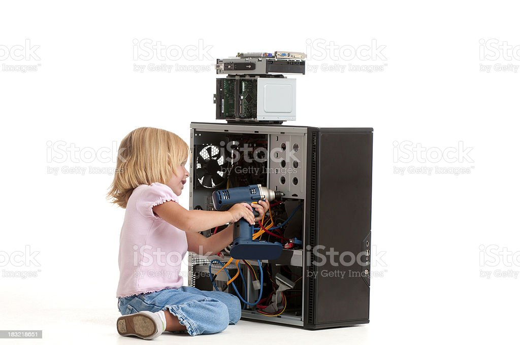 "Girl ""fixing"" her computer with a power drill. royalty-free stock photo"