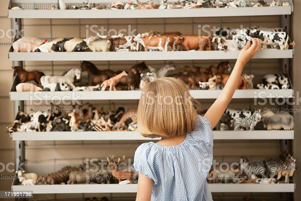 Girl reaching for plastic cow in toy store picture id171951786?b=1&k=6&m=171951786&s=612x612&h=g9 z34i82hbfngiwiqnc u5fufyh4madnapu7bz1xks=