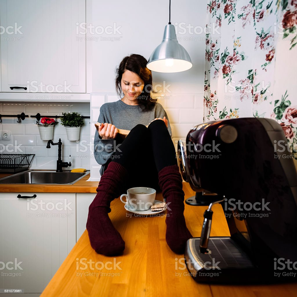 Girl reading a book at home royalty-free stock photo