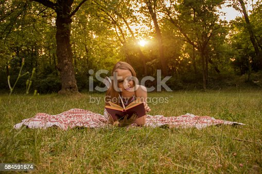 862602714 istock photo Girl reading a book 584591674