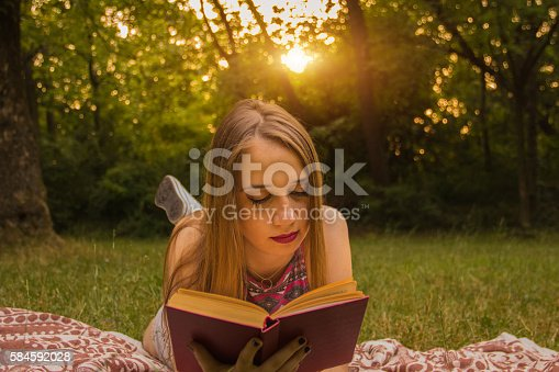 862602714 istock photo Girl reading a book 584592028
