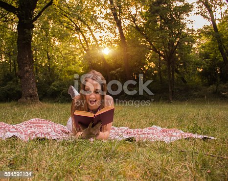 862602714 istock photo Girl reading a book 584592134