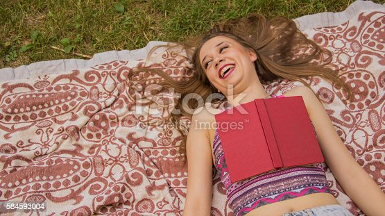 862602714 istock photo Girl reading a book 584593004