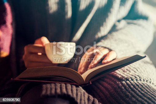 istock Girl reading and having a coffee 625908790