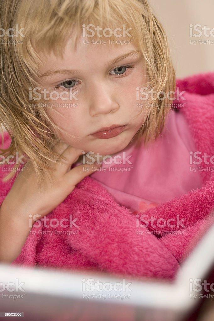girl reading book in bathrope royalty-free stock photo