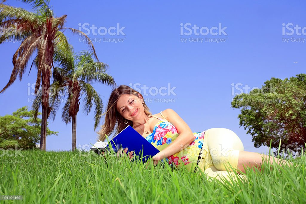 Girl reading book on vocation royalty-free stock photo