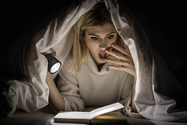 Girl Reading Horror Book stock photo