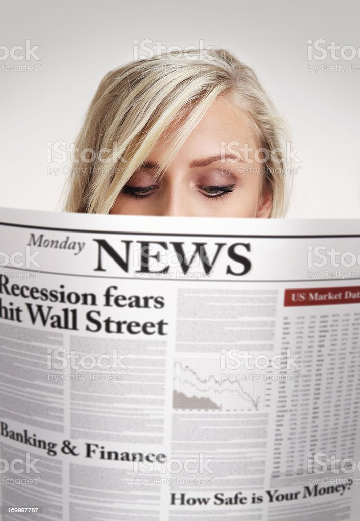 Girl reading newspaper with economic news royalty-free stock photo