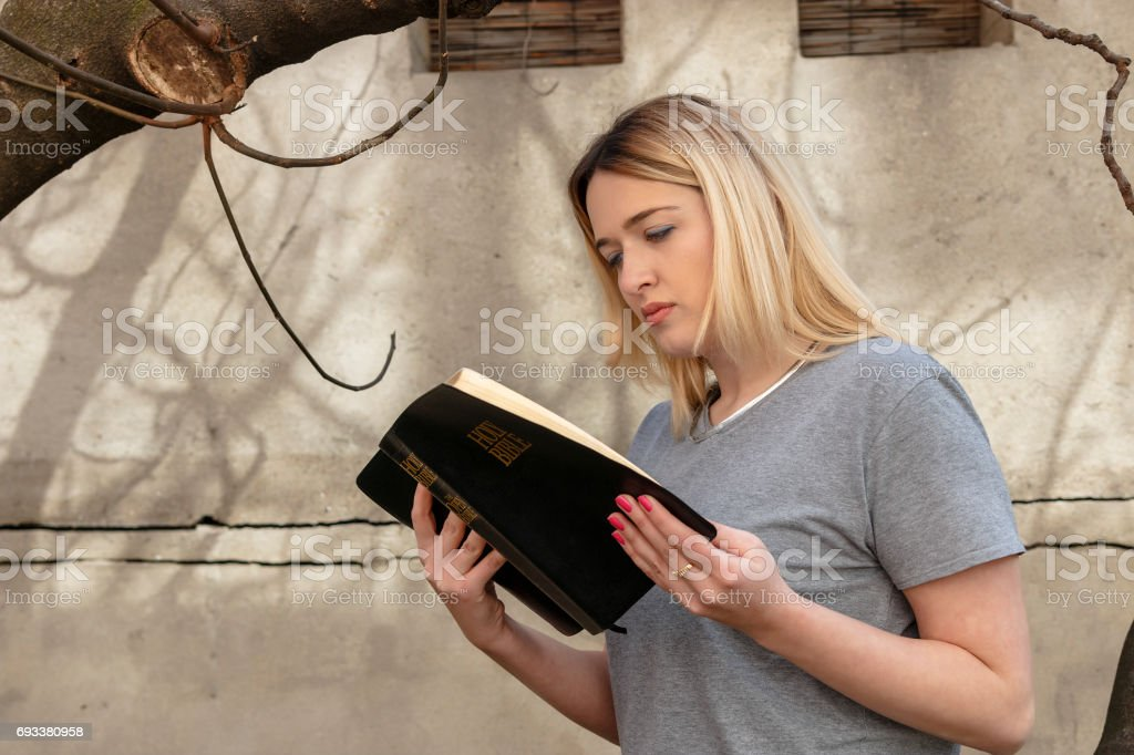 Girl reads the Bible stock photo