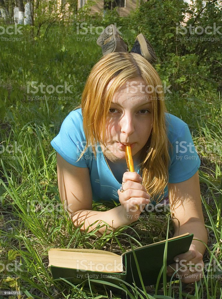 girl reads the book. royalty-free stock photo