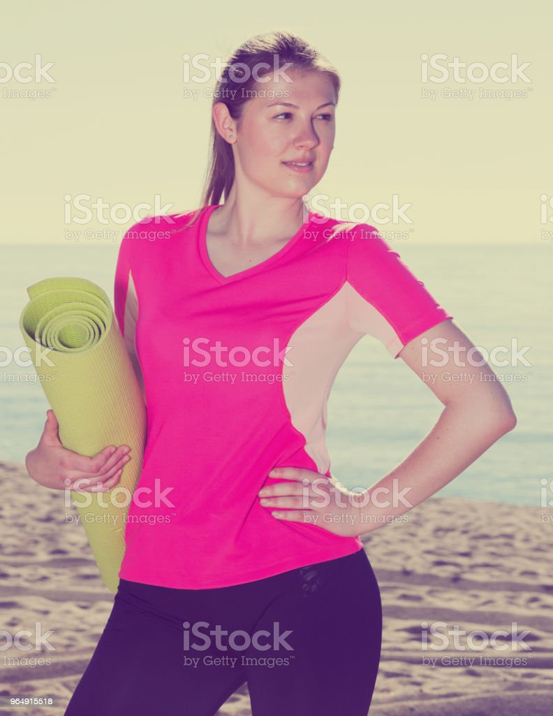 Girl ready for workout on seashore royalty-free stock photo