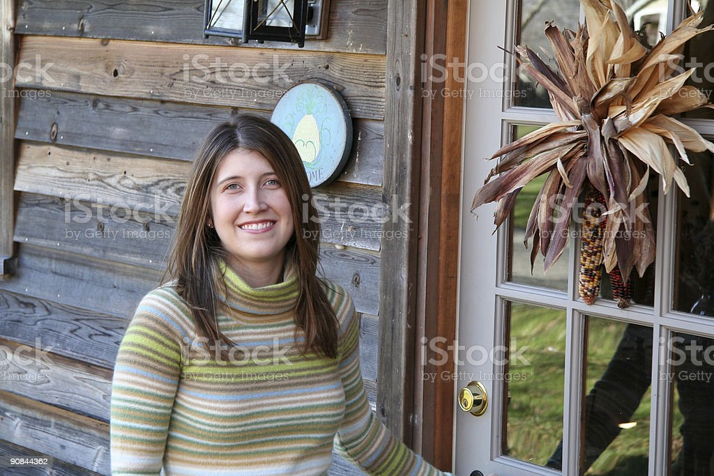 Girl ready to enter bed and breakfast royalty-free stock photo