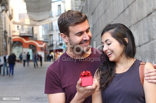 Girl receiving a surprise from his loved one.
