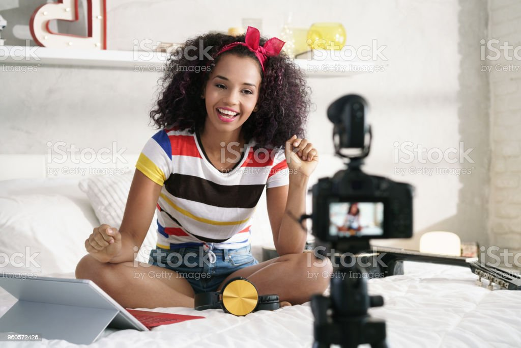 Girl Recording Vlog Video Blog At Home With Camera stock photo