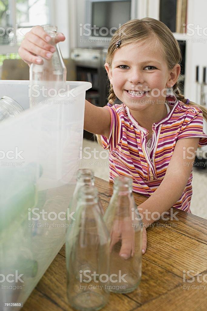 A girl recycling 免版稅 stock photo