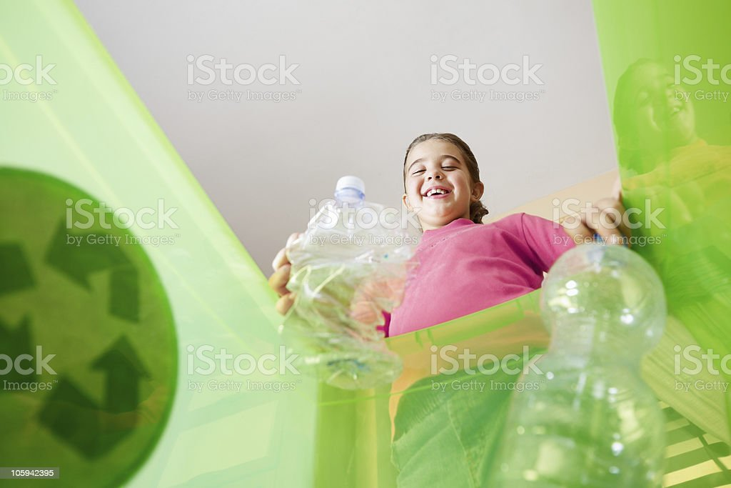 Girl recycling plastic bottles stock photo