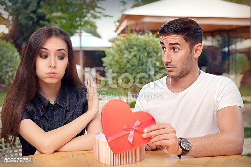 istock Girl Refusing Heart Shaped Gift From Her Boyfriend 506676754