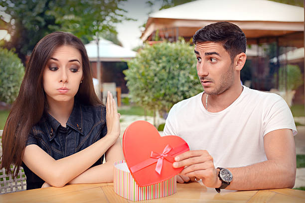 girl refusing heart shaped gift from her boyfriend - ugly girl stock photos and pictures