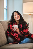 istock Girl relaxed at home holding a coffee mug 1220501594