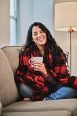 istock Girl relaxed at home holding a coffee mug 1220501624