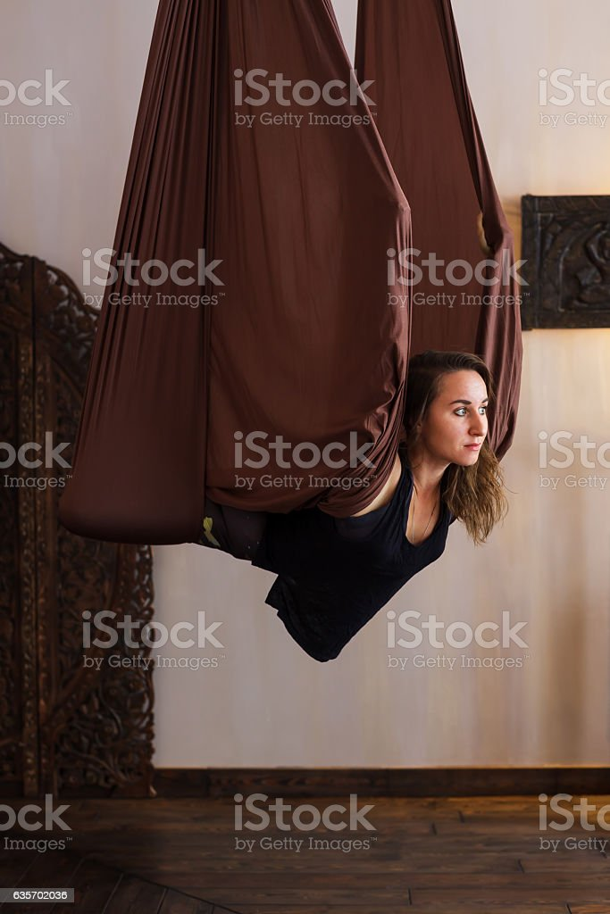 Girl relaxes on a hammock and doing yoga. royalty-free stock photo