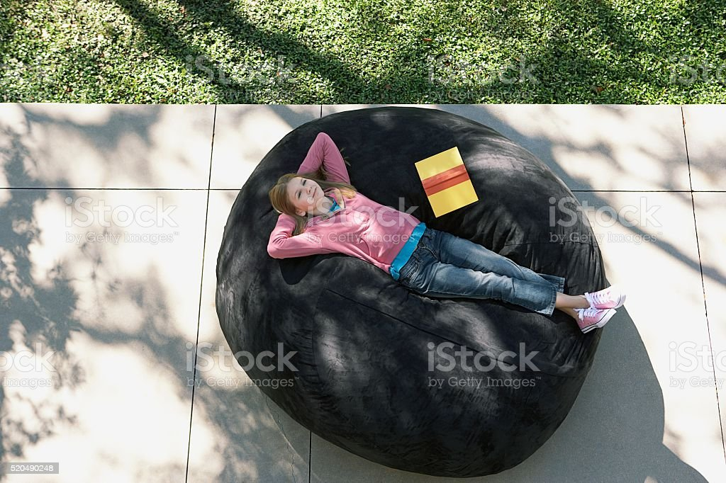 Girl relaxes with a book stock photo