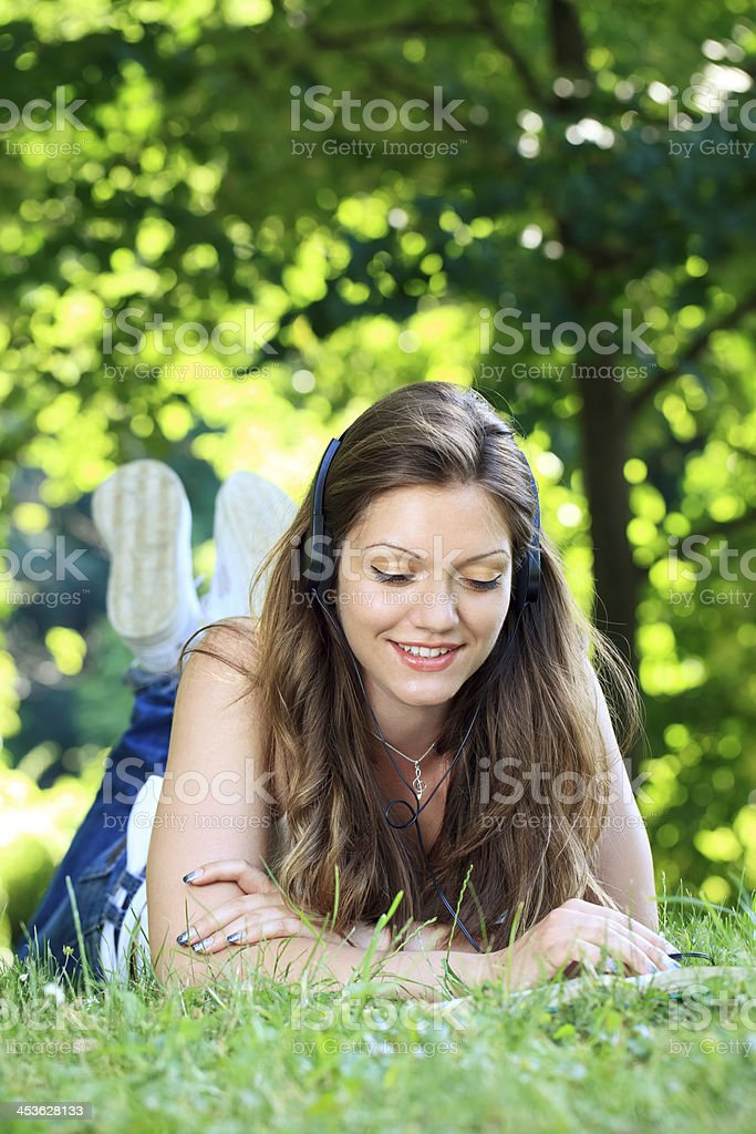 girl relaxing and enjoying on grass royalty-free stock photo