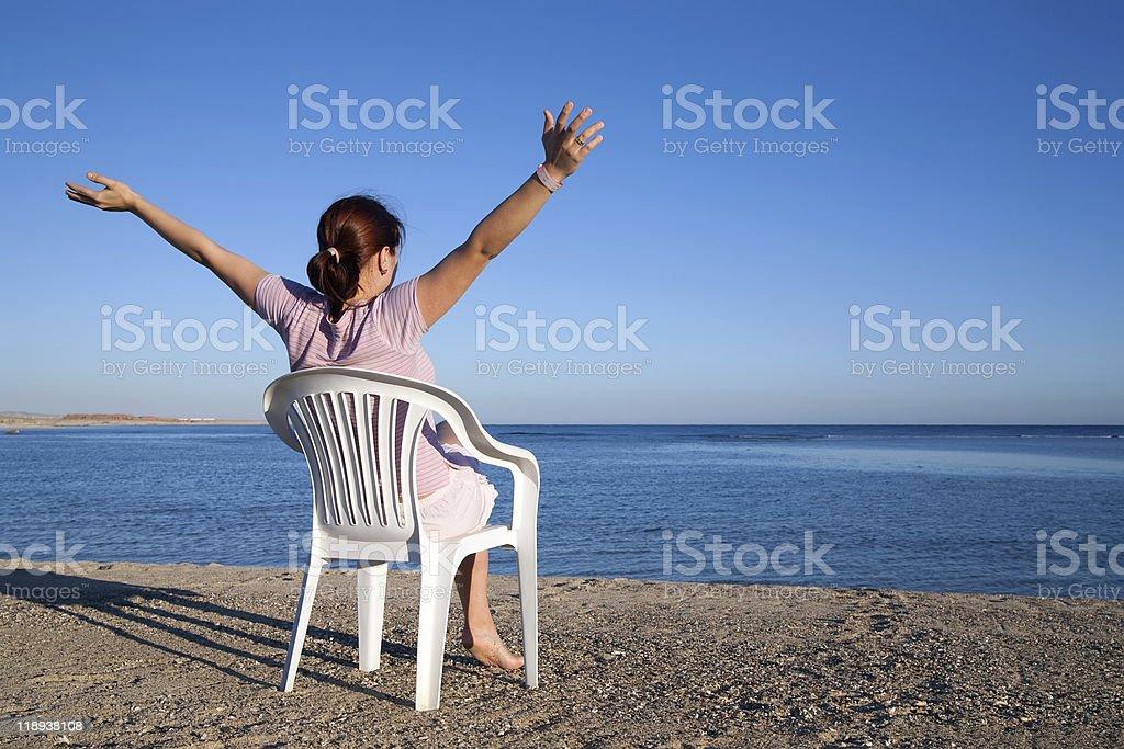 girl  relaxing at resort beach stock photo
