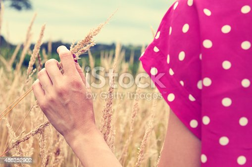 523172398istockphoto Girl relaxing in a wheat-field. 486252902