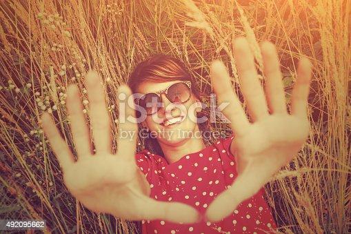 523172398istockphoto Girl relaxing in a wheat-field. 492095662