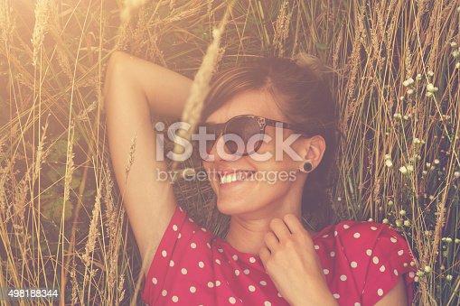 523172398istockphoto Girl relaxing in a wheat-field. 498188344