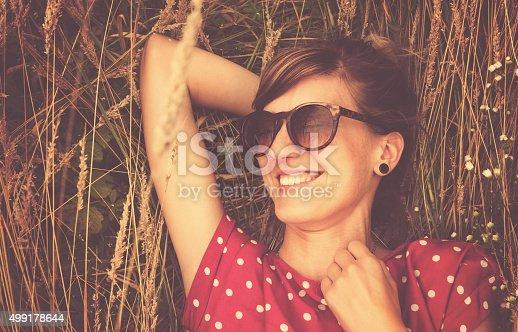 523172398istockphoto Girl relaxing in a wheat-field. 499178644