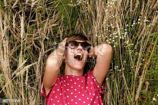 523172398istockphoto Girl relaxing in a wheat-field. 507722416