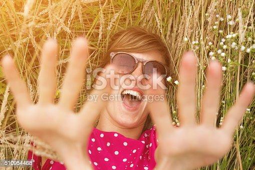 523172398istockphoto Girl relaxing in a wheat-field. 510954468