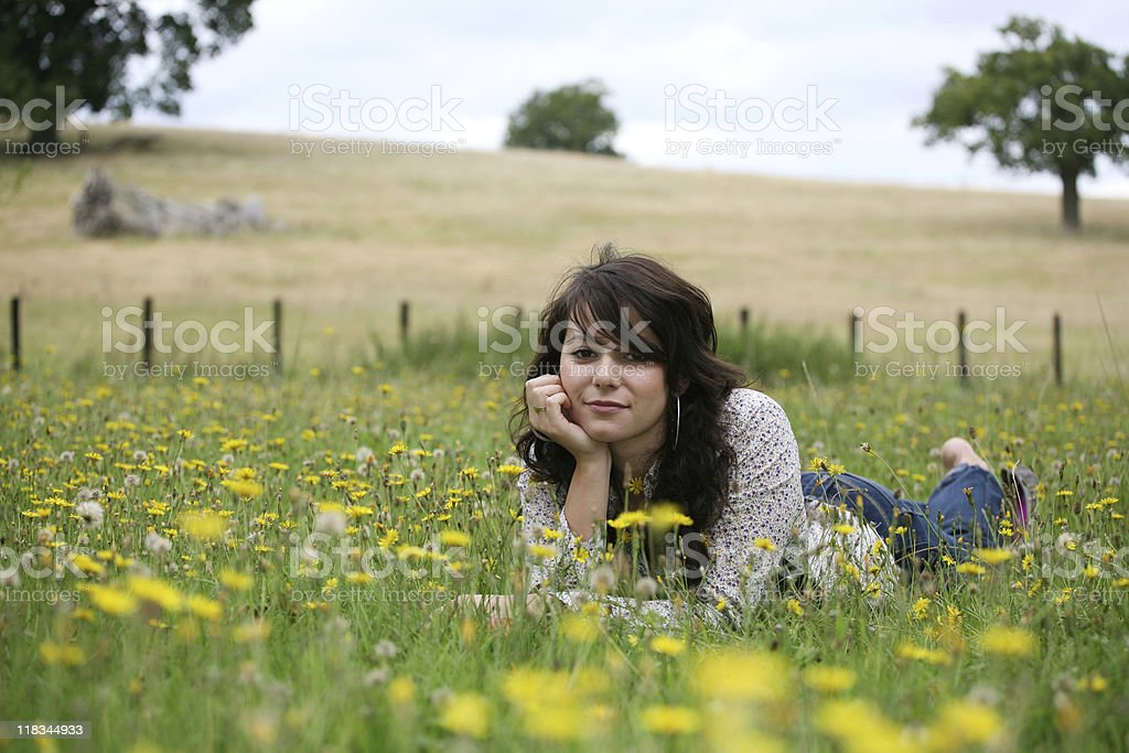 Girl Relaxing in Field royalty-free stock photo