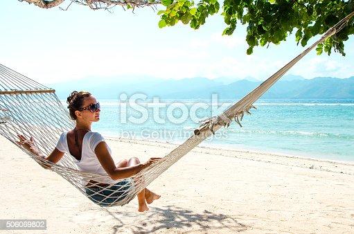 istock Girl Relaxing In Hammock - Stock image 506069802