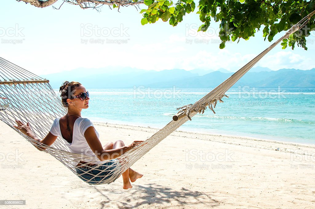 Girl Relaxing In Hammock - Stock image stock photo