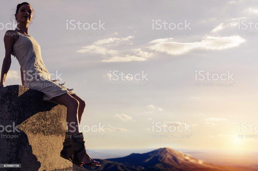 girl relaxing near volcano eruption stock photo