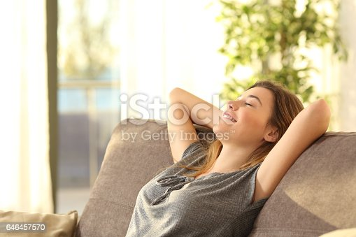 istock Girl relaxing on a sofa at home 646457570