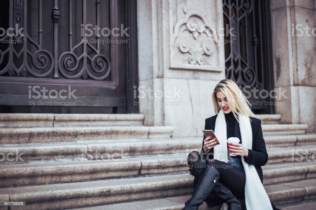 Girl relaxing on steps stock photo