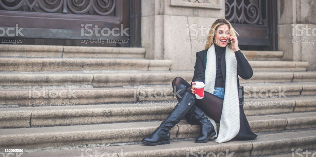 Girl relaxing on steps stock photo