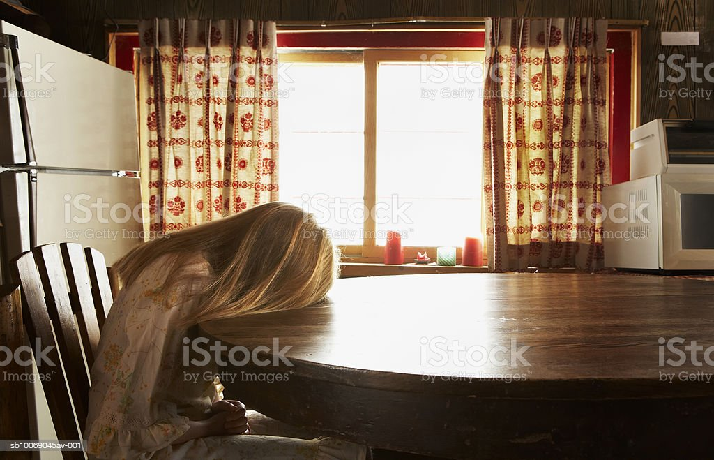 Girl (10-11) relaxing on table royalty-free stock photo