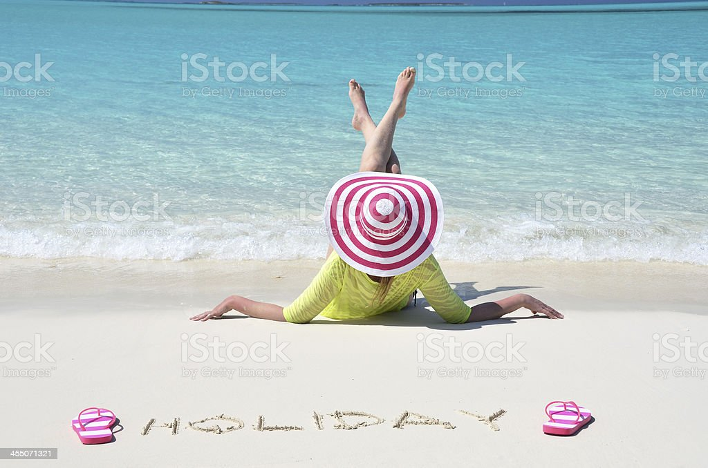 Girl relaxing on the beach of Exuma, Bahamas stock photo