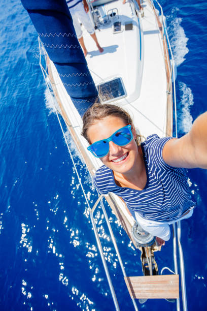 Girl relaxing On Yacht in Greece stock photo