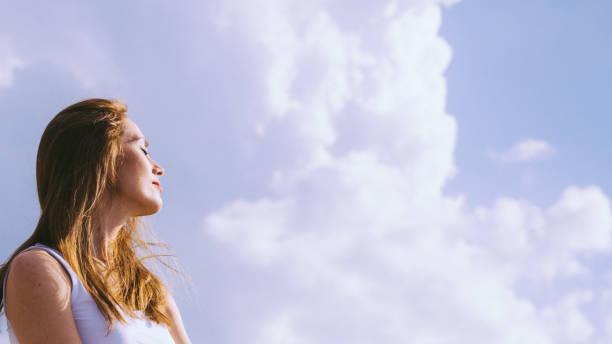 girl relaxing outdoor enjoying sunlight - vitamin d стоковые фото и изображения