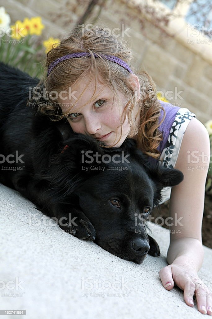 Girl Relaxing with Dog royalty-free stock photo