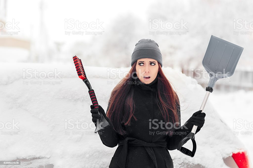 Girl Removing Snow from the Car stock photo
